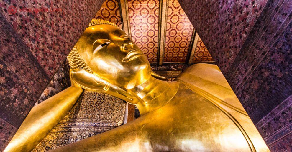 O maior buda reclinado da Tailândia, fica em Bangkok, a capital do país. Neste post damos todas as dicas sobre a Tailândia. Este Buda fica na parte antiga da cidade, é totalmente dourado e fica em uma sala com os pilares e tetos totalmente adornados em vermelho e dourado.