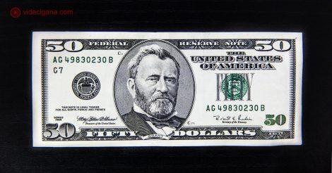 Encontrar a melhor casa de cambio pode não ser das missões mais fáceis. Viajar tranquilo e trocar seus reais por dólares ou euros requer cuidado para não pagar taxas abusivas. Na foto, uma nota de cinquenta dólares em um fundo preto.