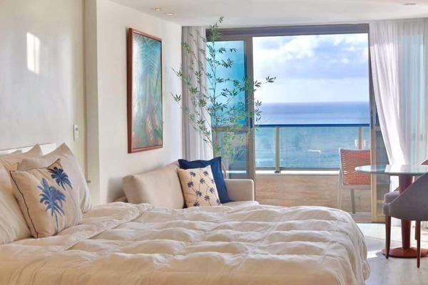 Vista para o mar direto da cama
